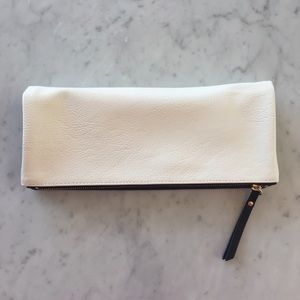 White and Black Reversible Clutch Faux Leather.